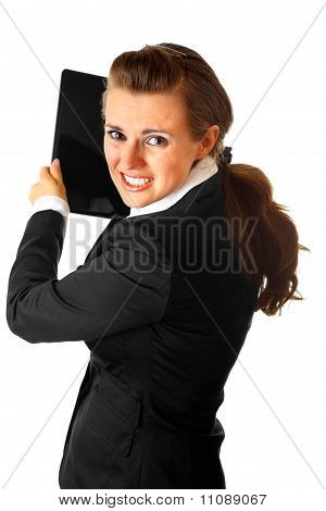 Stressed modern business woman brandishing laptop isolated on white