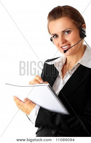 Smiling modern business woman with headset and notebook isolated on white