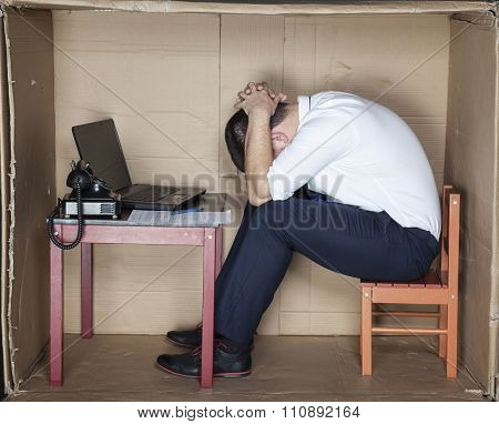 Tired Businessman Sitting In The Office