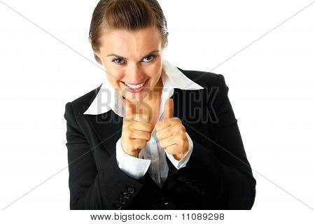 Smiling modern business woman showing thumbs up gesture isolated on white