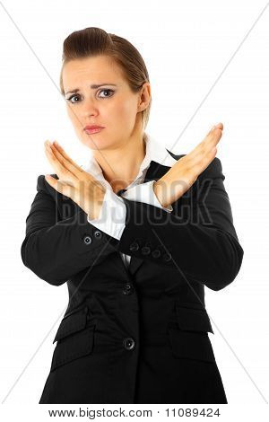 Frustrated modern business woman with crossed arms. Forbidden gesture.