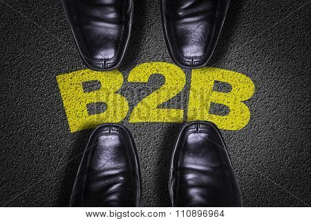 Top View of Business Shoes on the floor with the text: B2B