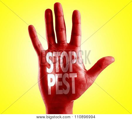 Stop Pest written on hand with yellow background