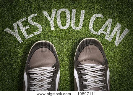 Top View of Sneakers on the grass with the text: Yes You Can