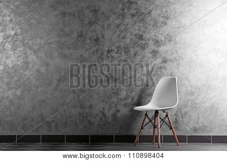 Stylish conception with one white chair on grey background