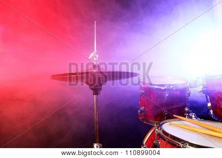 Drums cymbal on smoked stage, close-up