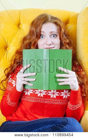Beautiful Shocked Young Woman Reading Book