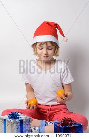 Little Girl Juggling Tangerines
