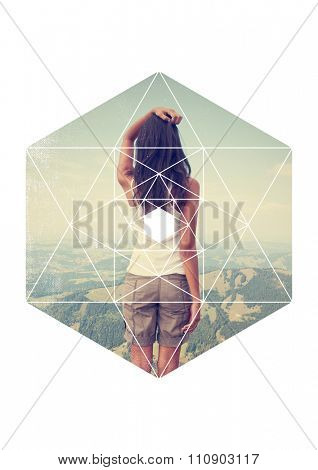 Rear View of Brunette Woman Wearing Shorts and Tank Top Standing with Hand on Top of Head and Enjoying View from Scenic Overlook of Lush Green Mountain Valley with Hexagon Overlay with Geometric Lines