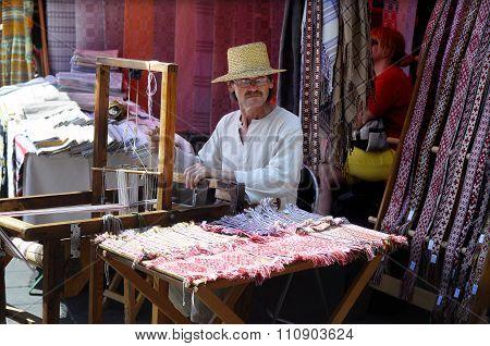 Weaver at street fair