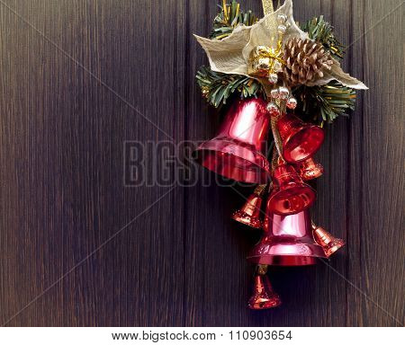 Red bells on the wooden background