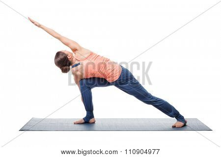 Young fit woman doing Ashtanga Vinyasa Yoga asana Parivrtta parsvakonasana - revolved side angle pose isolated on white