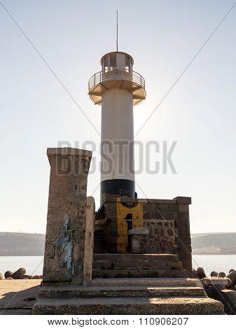 Varna, Bulgaria - 18 November, 2015: Lighthouse In The Sea Port Of Varna. November 18, 2015 In Varna