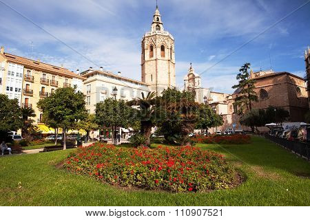 VALENCIA, SPAIN -  NOV 4 2015 : The sun shines down on Plaza de la Reina and the Cathedral.