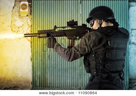 Street Assault, Riot Police Firing His Submachine Gun