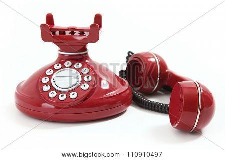 red retro-styled telephone on white background