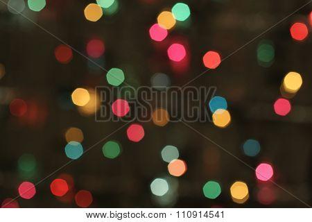 Defocused colorful lights on black background
