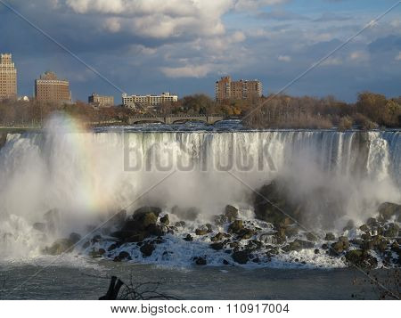 Rainbow and interesting sky over Niagara Falls, Ontario facing towards the New York Side