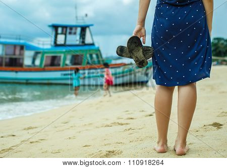 Woman Walks Along The Seashore
