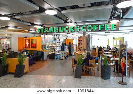 GENEVA, SWITZERLAND - NOVEMBER 19, 2015: Starbucks Cafe interior. Starbucks Corporation is an American global coffee company and coffeehouse chain based in Seattle, Washington