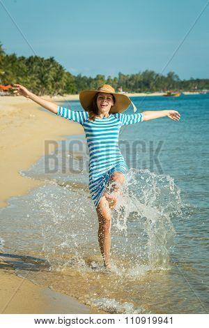 Happy Woman Enjoying Beach Relaxing Joyful In Summer By Tropical Blue Water. Beautiful Model Happy O