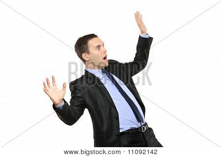 A View Of A Shocked Young Businessman
