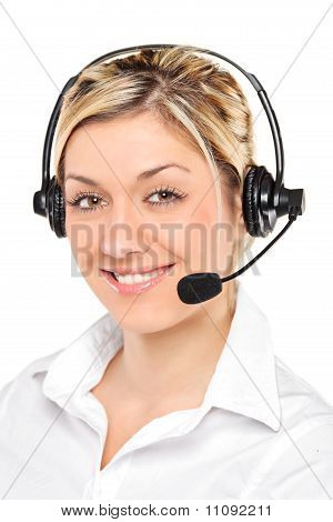 Portrait Of A Young Female Customer Service Operator Wearing A Headset