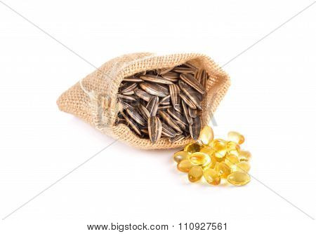 Fish Oil Capsule With Sunflower Seeds On White Background