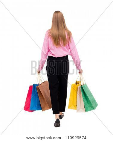 back view going woman with shopping bags  beautiful girl in motion.  backside view of person. Rear view people collection. Isolated over white background. Woman businessman went off with lot of bags