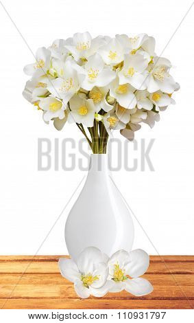 Beautiful Jasmine Flowers With Leaves On Wooden Table Isolated On White