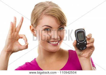 Woman Holding Glucometer And Showing Sign Ok, Checking And Measuring Sugar Level, Concept Of Diabete