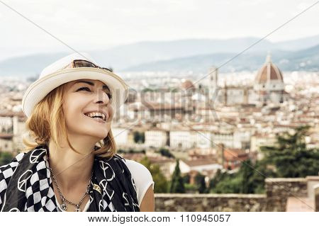 Pretty Woman Happily Laughs With The City Of Florence Behind Her