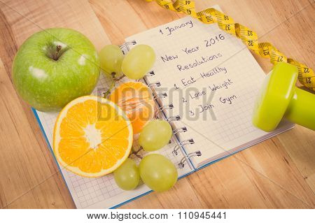 Vintage Photo, New Years Resolutions Written In Notebook And Fruits, Dumbbells With Centimeter