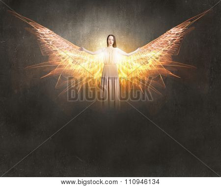 Attractive woman with angel wings on sky background