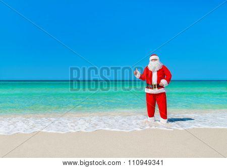 Christmas Santa Claus At Tropical Beach Thumbs Up Hand Gesture
