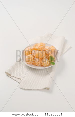 plate of peeled tangerines on white place mat