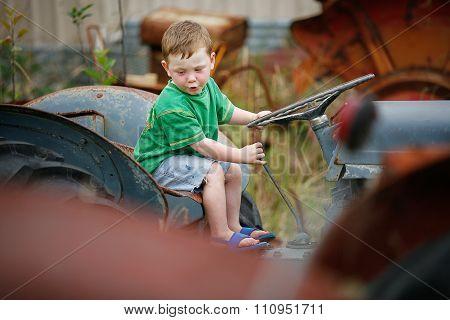 Little Boy On A Tractor