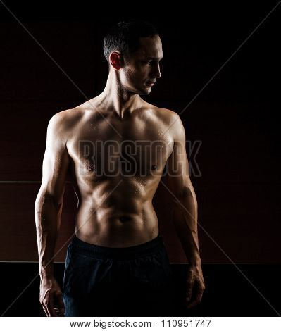 Muscular Handsome Man  Isolated On Black Background