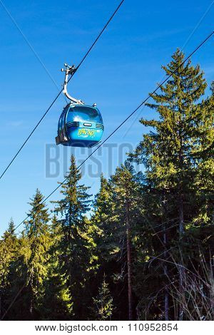 Close Up Bansko Cable Car Cabin, Pine Trees  Against Vibrant Blue Sky, Bulgaria