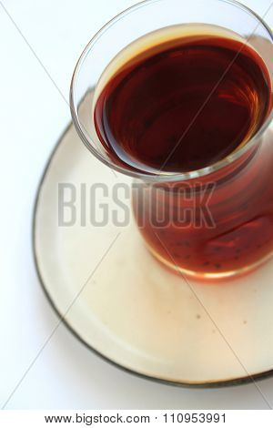 a glass of black tea