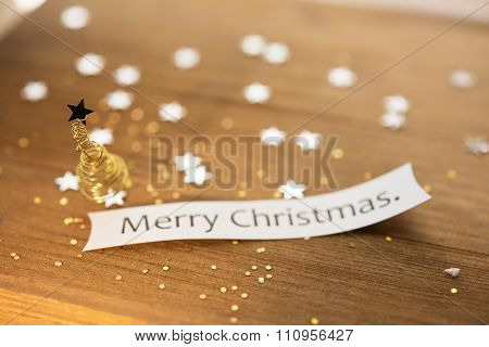Small Christmas tree made form gold or brass wire, Christmas background. Extremely shallow depth of field.