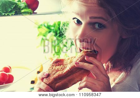 Woman Eats at Night stealing The Refrigerator