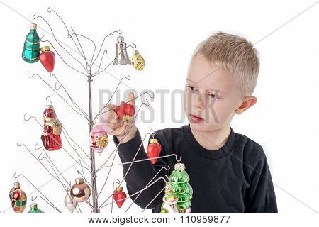 Child Is Decorating Metalwire Christmas Tree, With Glass Ornaments