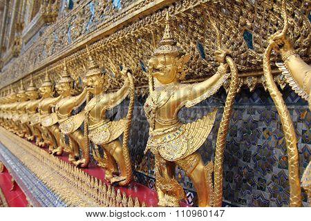 Garuda (Krut) battling naga serpent, Thai statue, Religious.