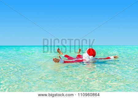 Santa Claus Swimming In Ocean Water, Christmas Concept