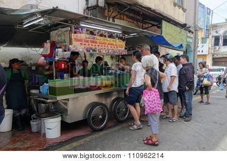 Street Hawker Sells Cendol In Penang, Malaysia.