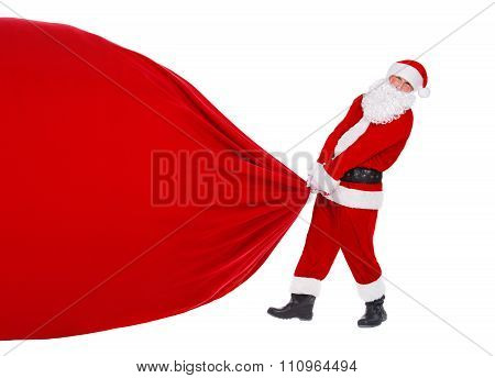Santa Claus Pull Christmas Bag With Presents Isolated On White