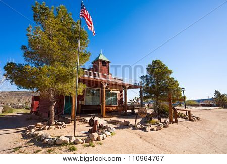 Pioneer town church building with US flag