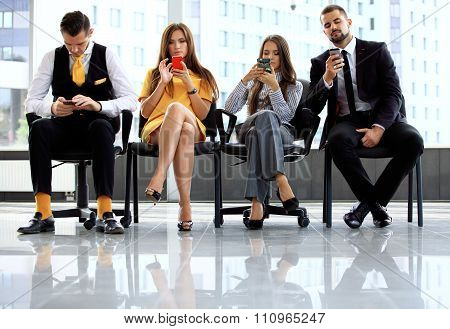 Business people waiting for job interview
