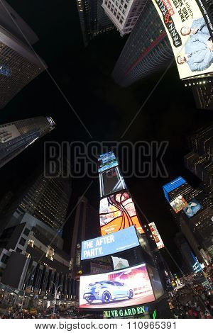 Fisheye lens photo of Times Squares at night.